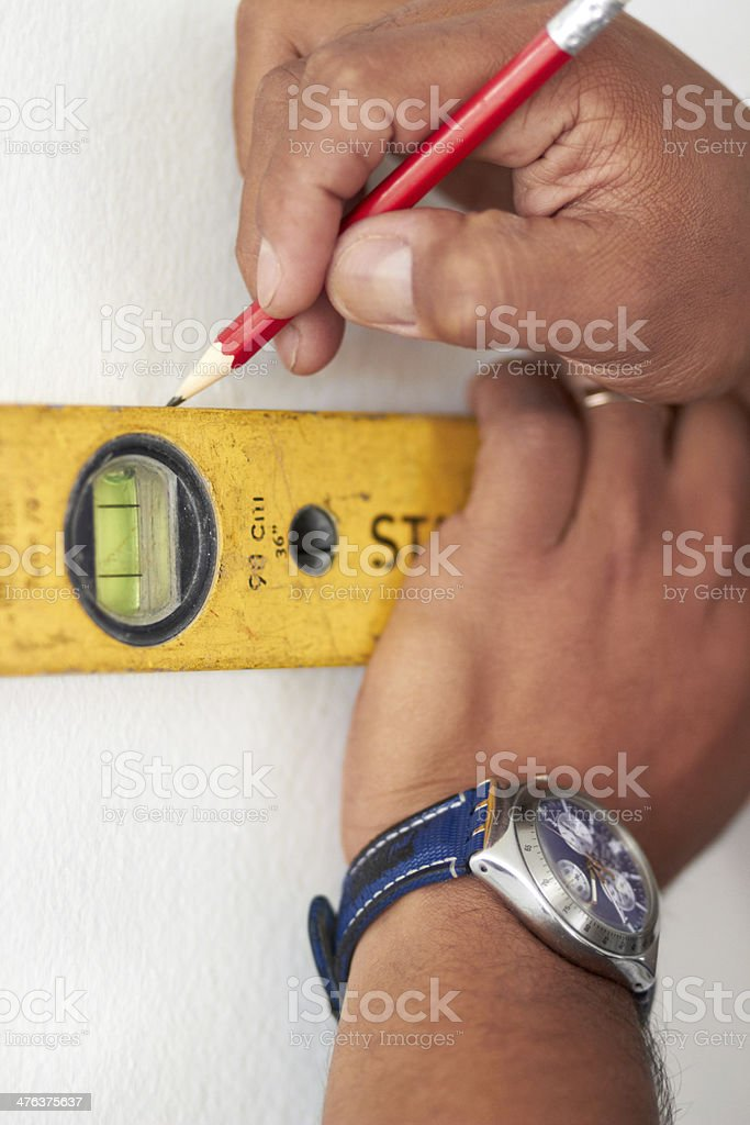 Measuring with a spirit meter royalty-free stock photo