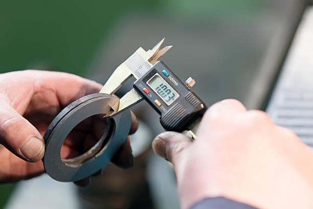 Measuring with Digital Vernier Caliper stock photo