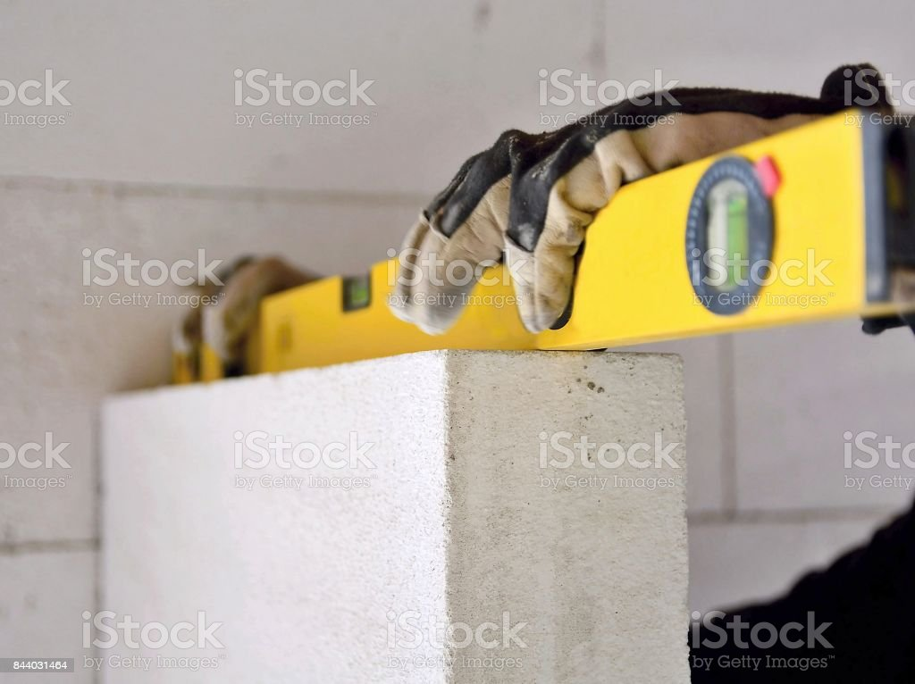 Measuring with water level stock photo