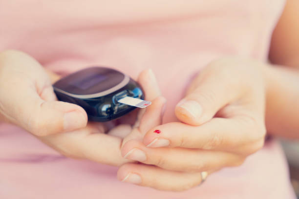 measurnig blood sugar level - metabolic syndrome stock photos and pictures