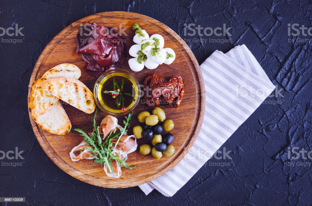 Meat and cheese plate antipasti snack stock photo