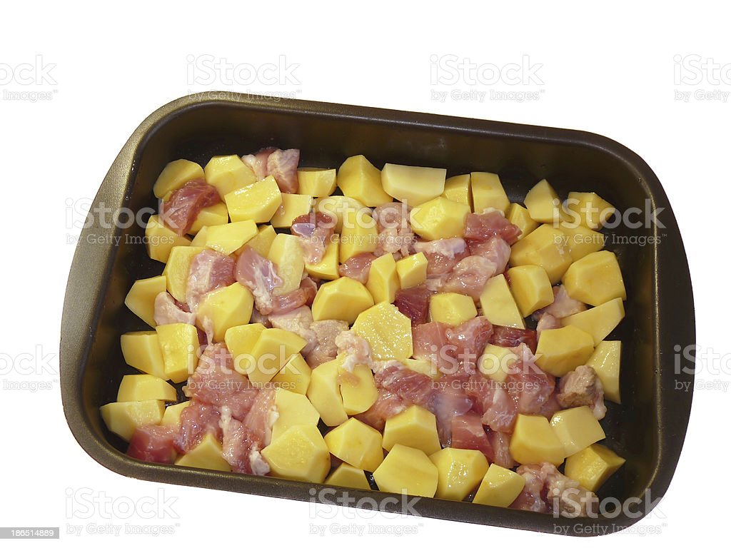 Meat and potatoes in trays, isolated on a white background royalty-free stock photo