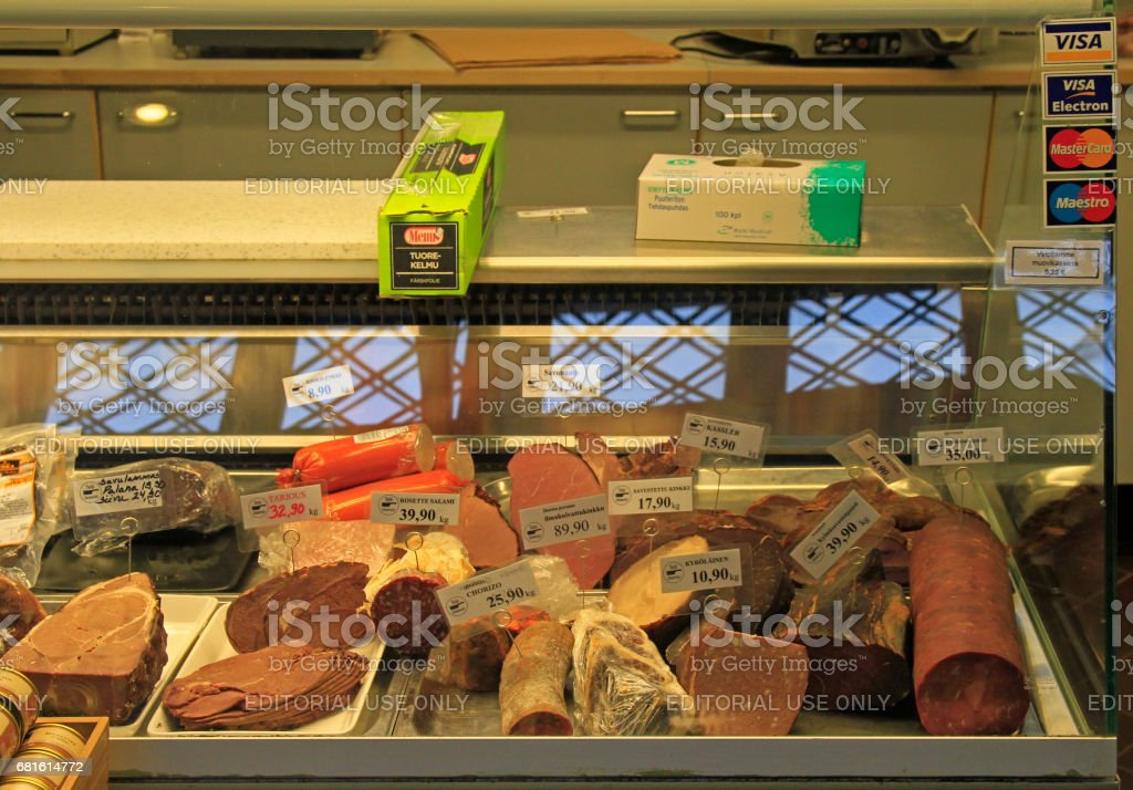 Meat and sausages on shopwindow at the european market stock photo