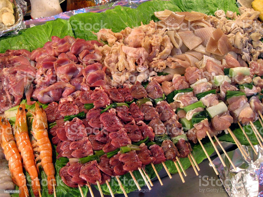 Meat and Skewers at Fast Food Stall in Seoul royalty-free stock photo