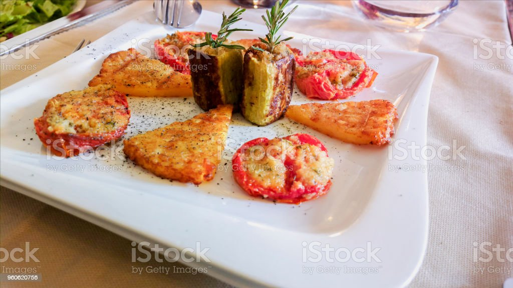 Meat and vegetable snacks. Aperitifs. Mediterranean cuisine on white tablecloth in Italian restaurant. - foto stock