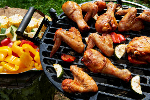 Meat and vegetables during grilling. Assorted types of chicken stock photo
