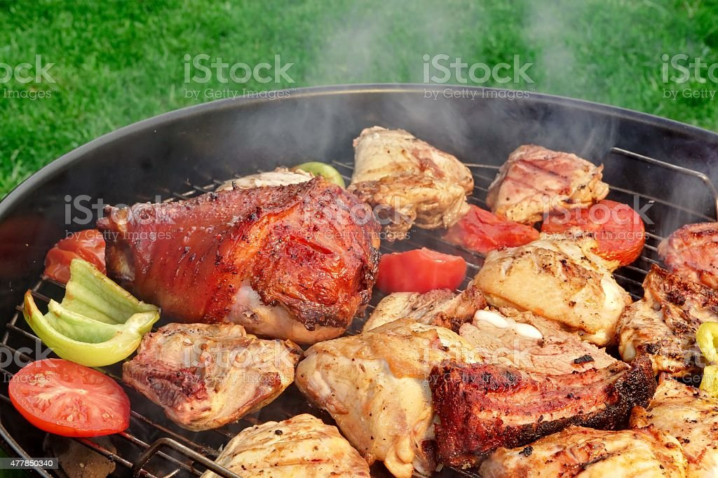 Meat And Vegetables Mix On The Hot BBQ Grill stock photo