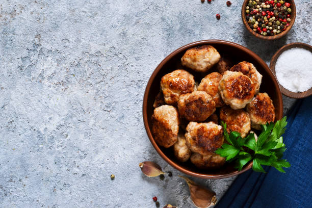 Meat balls with spices on a concrete background. View from above. Meat balls with spices on a concrete background. View from above. meatball stock pictures, royalty-free photos & images
