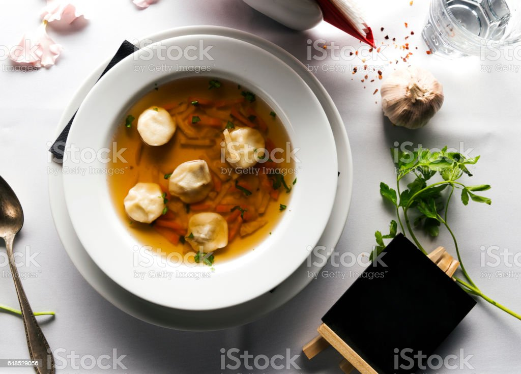 Meat broth with parsley in bowl stock photo