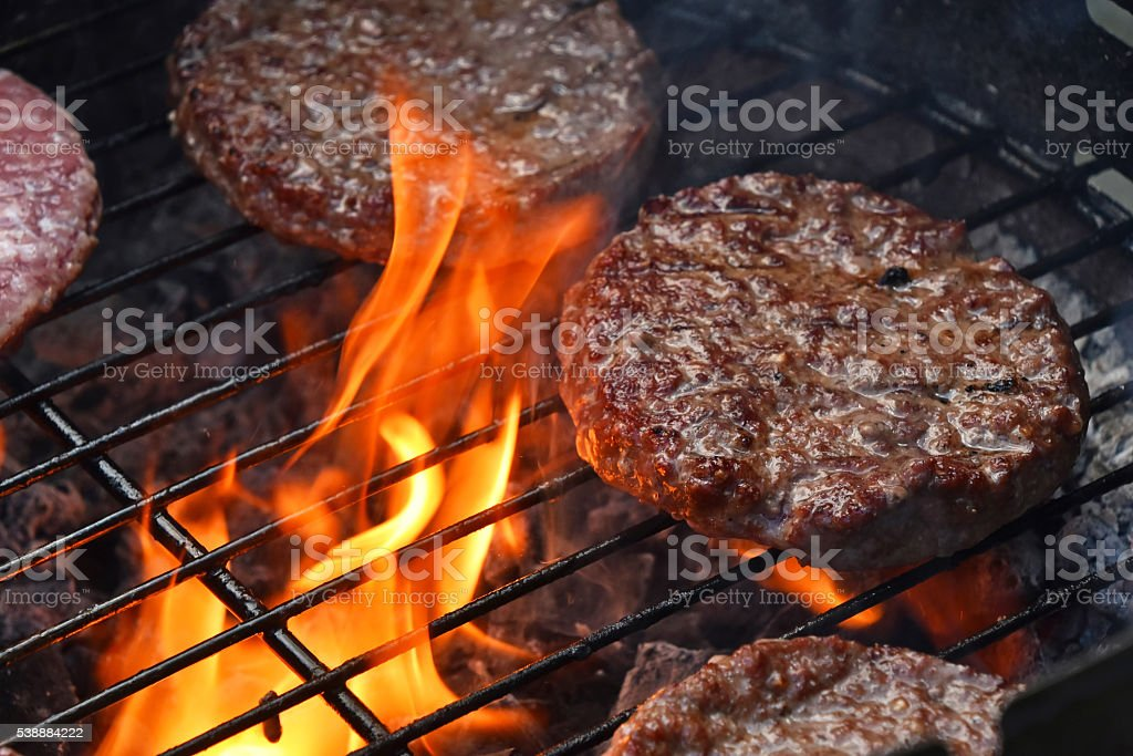 Meat burgers for hamburger grilled on flame grill stock photo