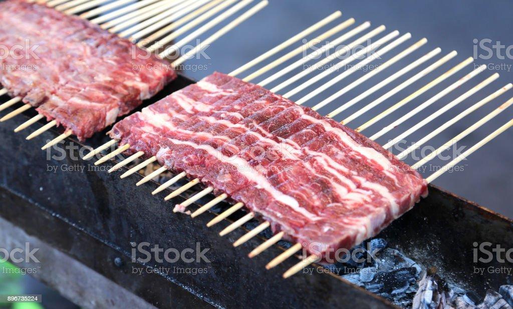 Meat called Arrosticini in italian language - foto stock