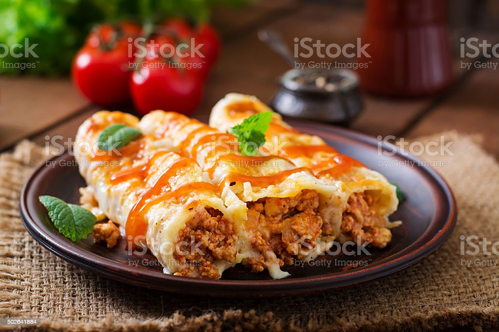 Meat cannelloni sauce bechamel stock photo