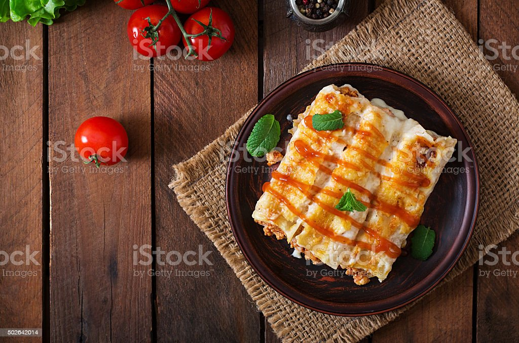 Meat cannelloni sauce bechamel. Top view stock photo