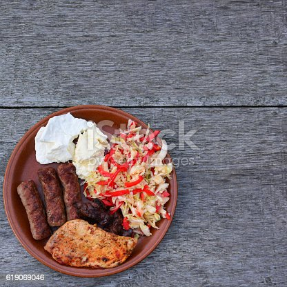 655793486istockphoto Meat, cheese and salad in the plate 619069046