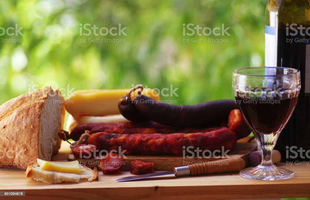 Meat, cheese, bread and red wine stock photo