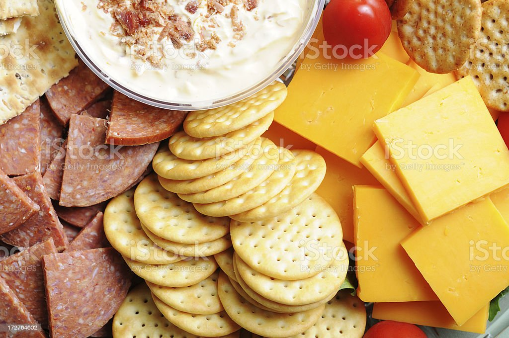 Meat, Cheese & Crackers Tray A delicious fresh meat, cheese and crackers tray with dip. Appetizer Stock Photo