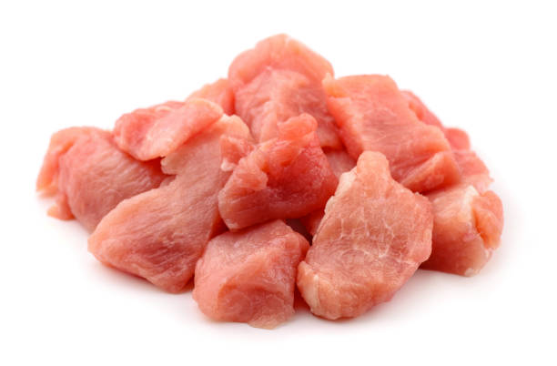 Meat chunks Raw fresh meat chunks isolated on white pork stock pictures, royalty-free photos & images