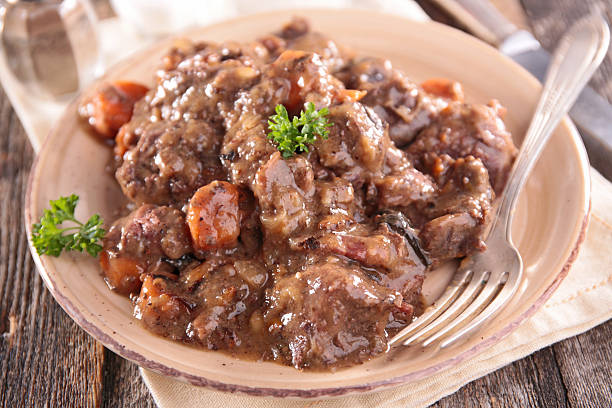 meat cooked with wine sauce meat cooked with wine sauce ragout stock pictures, royalty-free photos & images