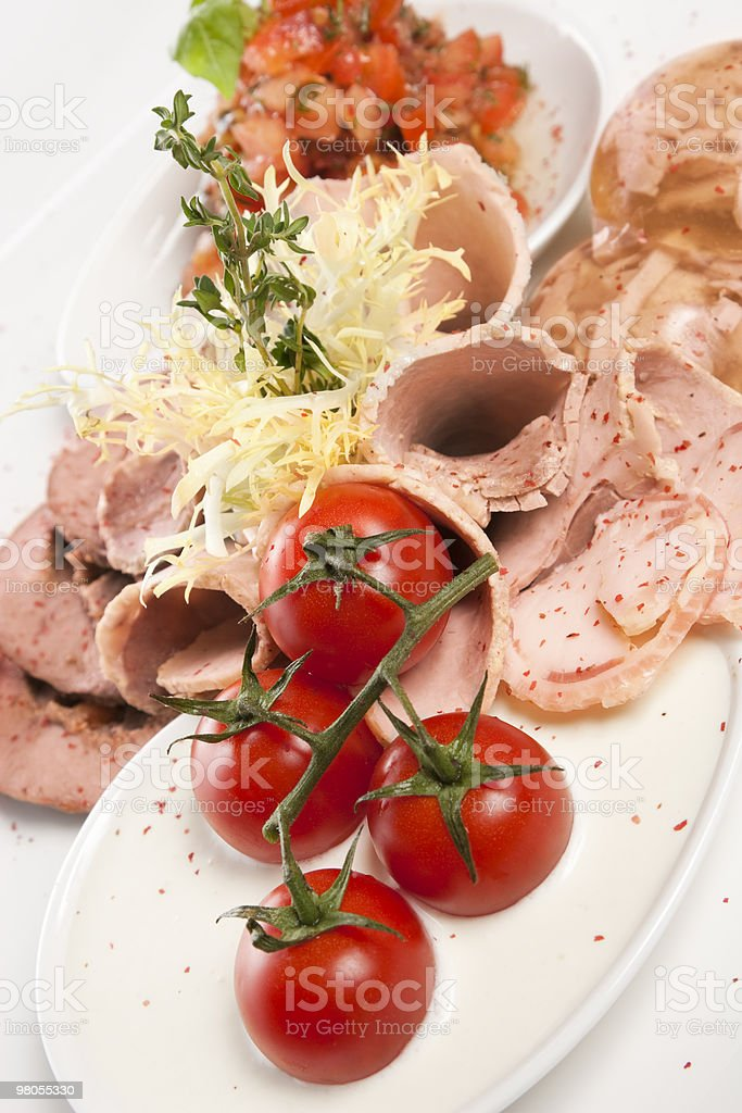 meat course,  salad of tomato royalty-free stock photo
