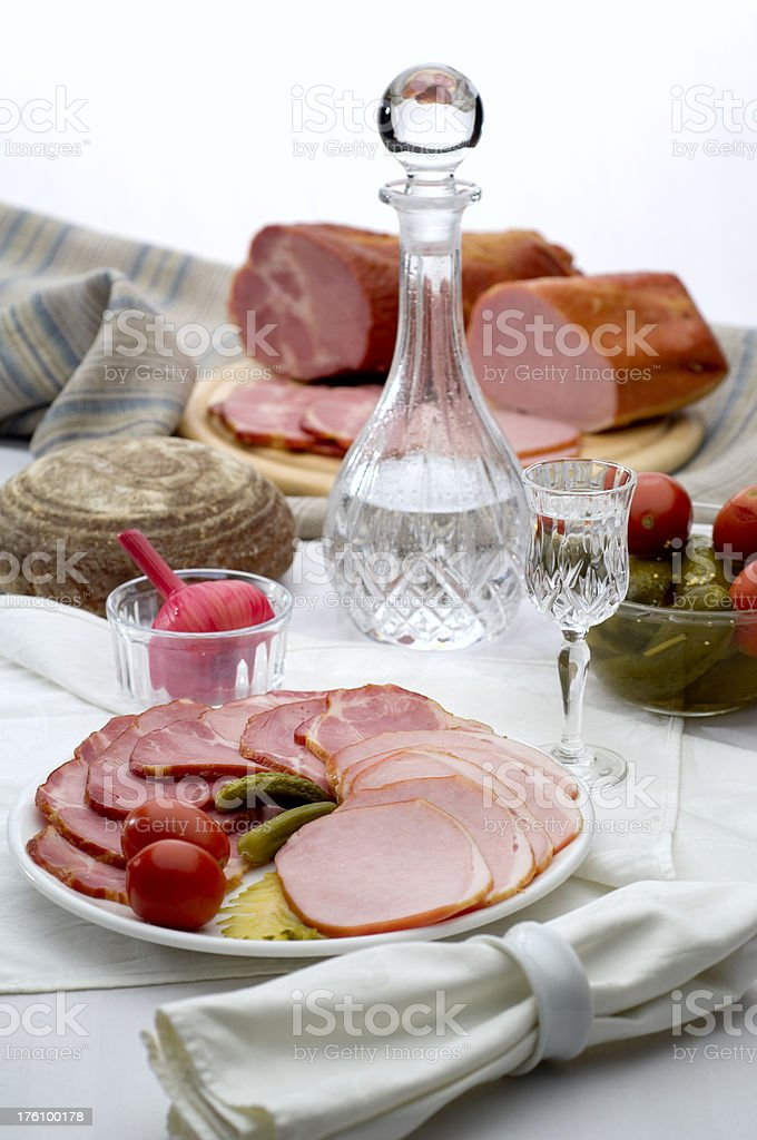 Meat delicatessen served with vodka royalty-free stock photo