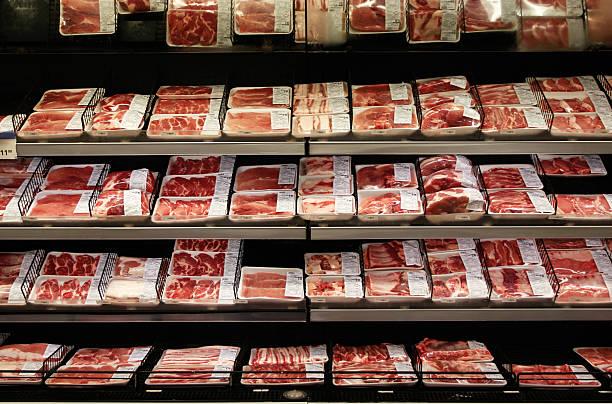 meat department in a supermarket - et stok fotoğraflar ve resimler