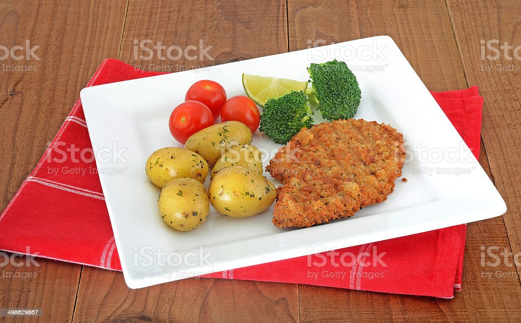 meat escalopes on white plate royalty-free stock photo