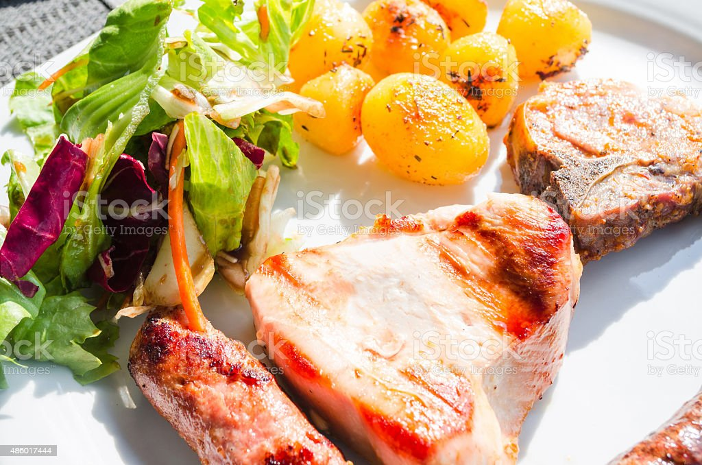 Meat, fried potatoes and salad. stock photo