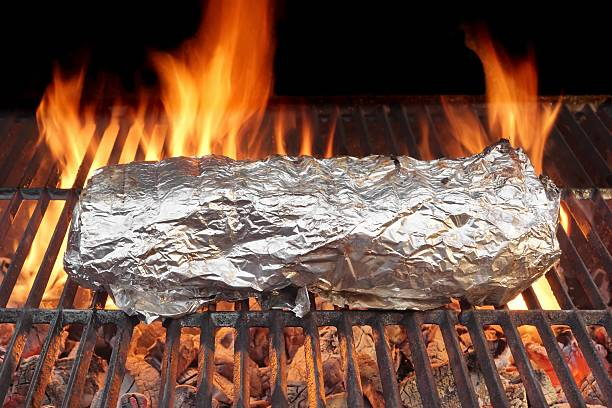 Meat Grilled in Foil  on Grill stock photo
