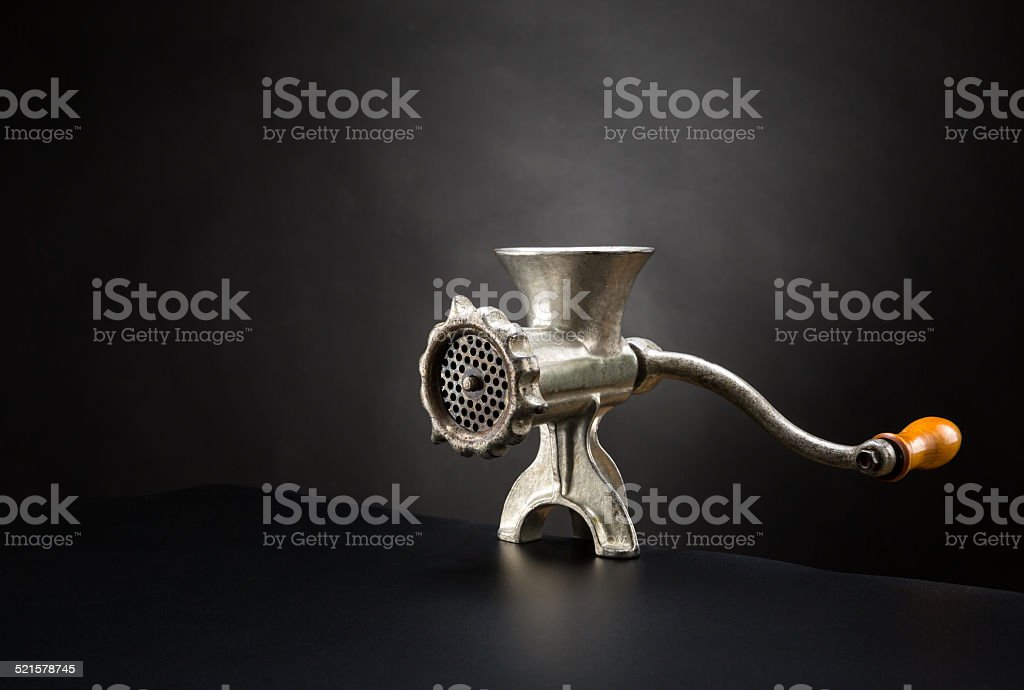 Meat grinder on a black background stock photo