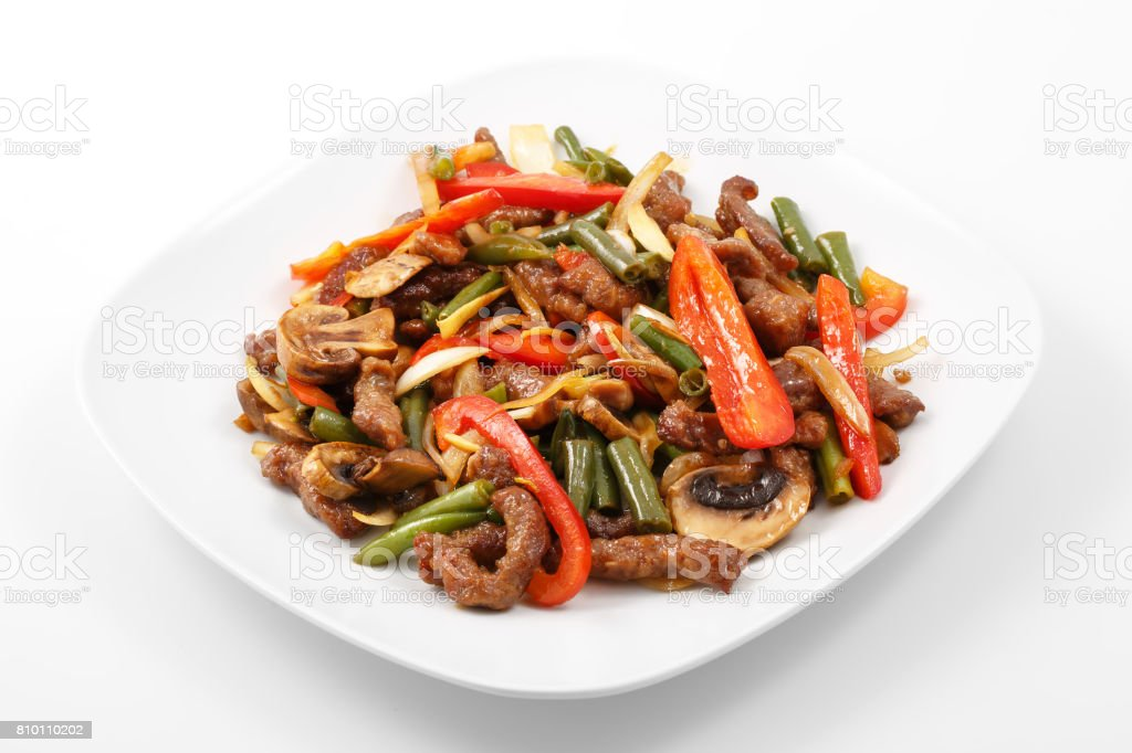 meat in Chinese, pork, Chinese sauce, mushrooms, green beans, bell pepper stock photo