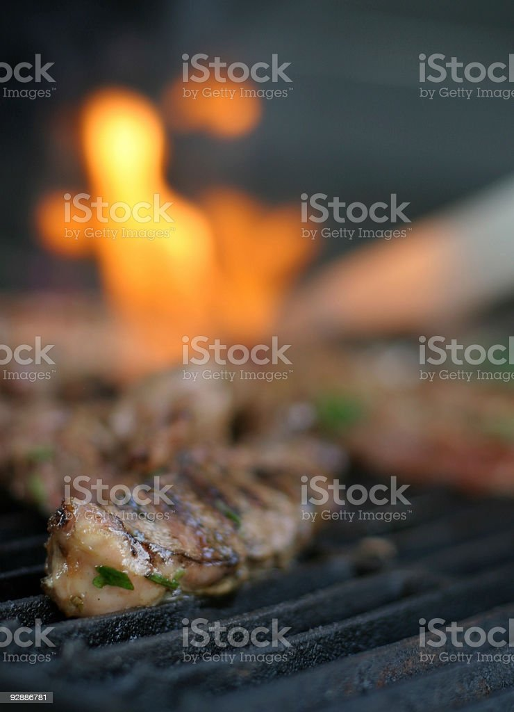 Meat is cooking on the grill stock photo
