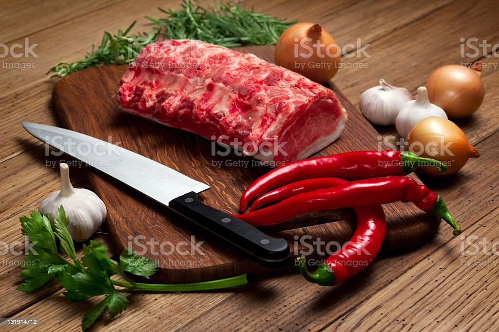 Meat, knife and vegetables royalty-free stock photo