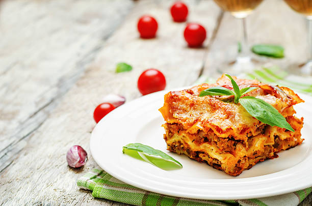 meat lasagna - italian food stock photos and pictures