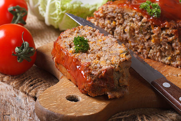 meat loaf close-up on a cutting board. horizontal - mash food state stock photos and pictures