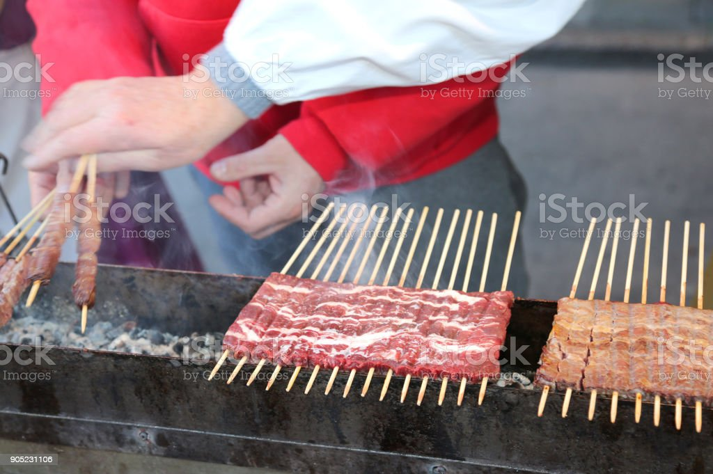 meat of lamb called Arrosticini in italian language. They are a typical dish of traditional of Abruzzo Region in Italy - foto stock