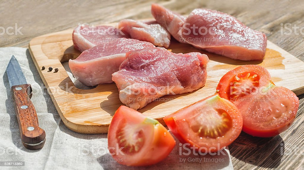 meat on a cutting board with shallow depth of field stock photo