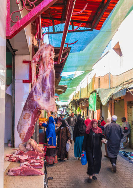 Meat on sale on a narrow street in the Medina, Marrakesh stock photo