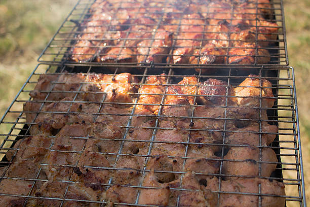 Meat on the grill close-up. stock photo