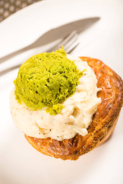 Meat Pie with mashed potato and mushy peas stock photo
