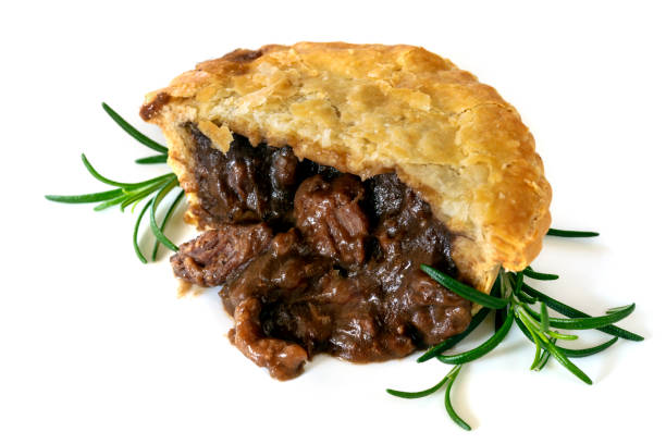 Meat pie with rosemary, cut, isolated on white background. stock photo