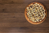 istock Meat pizza on wooden board. Made with Mozzarella, picanha meat, onion, cheese, tomato sauce. Filet Steak, meat, horizontal photo from the top. 1240627206