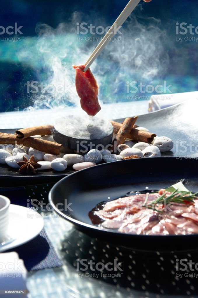 Meat preparation on pool background stock photo