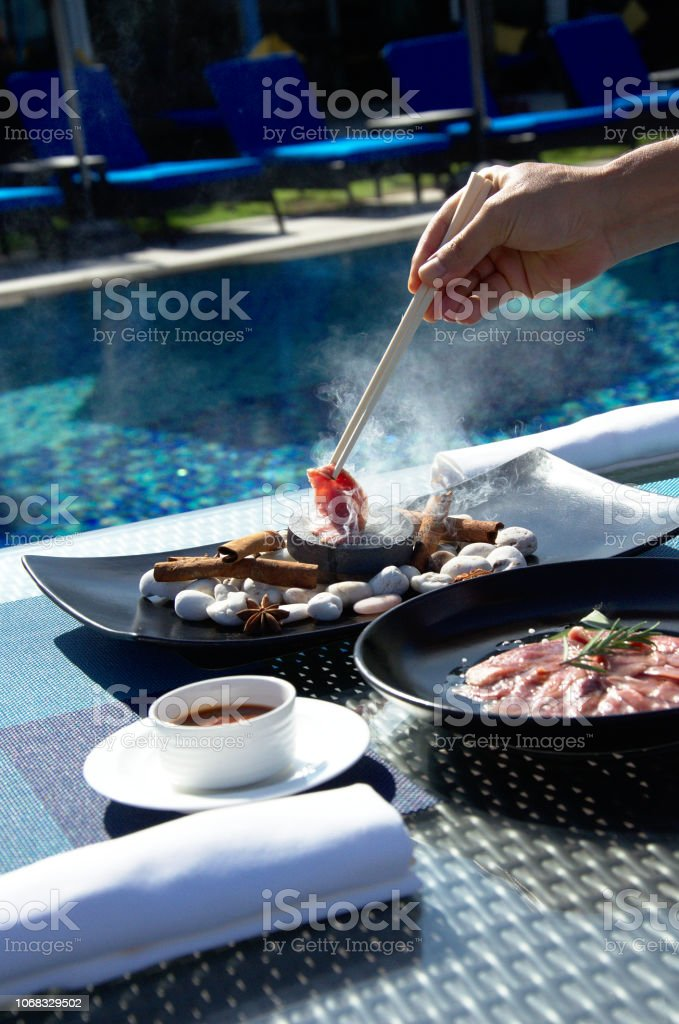 Meat prepared on a pool background stock photo