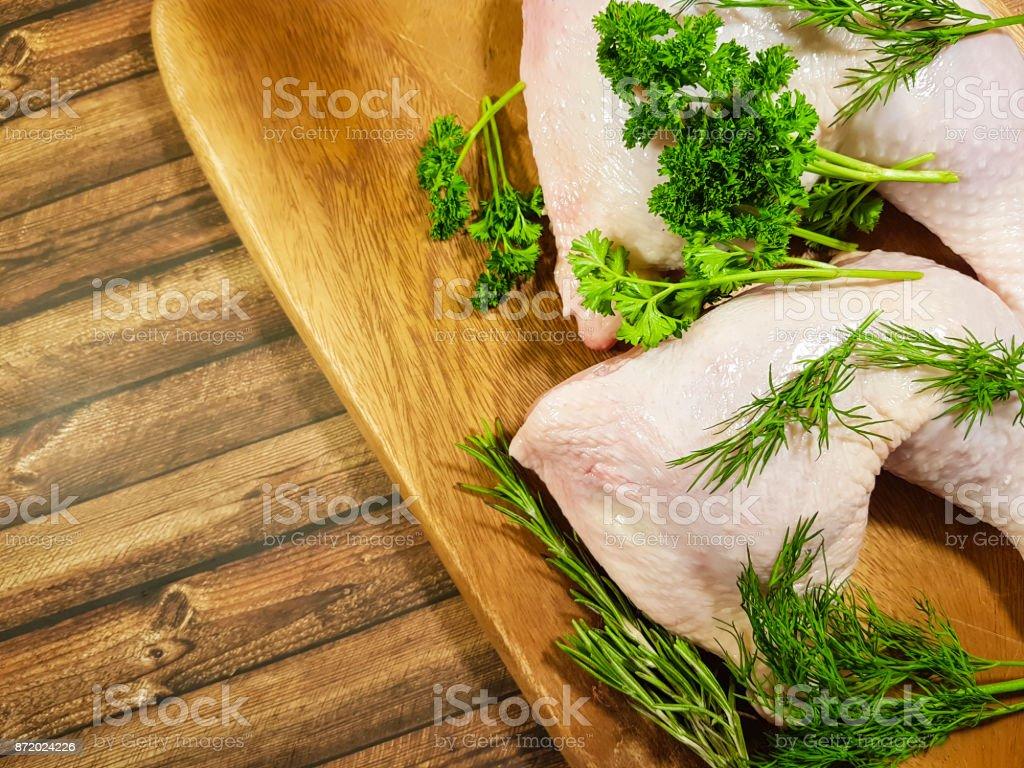meat raw chicken leg greens stock photo
