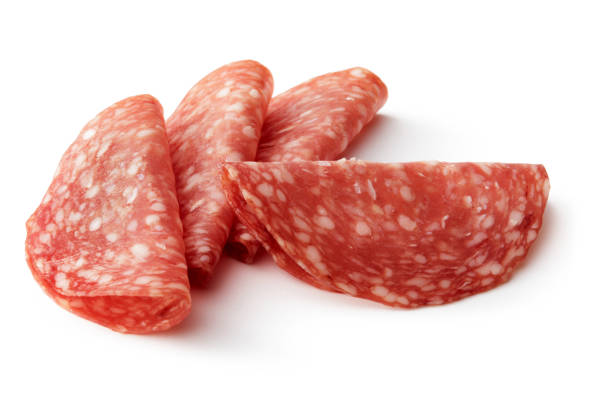 fleisch: salami, isolated on white background - salami stock-fotos und bilder