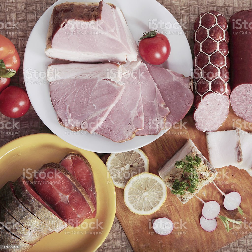 Meat, salmon, sausage and vegetables royalty-free stock photo