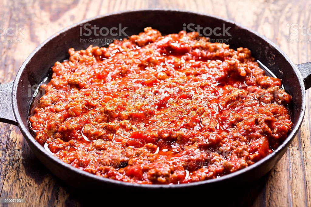 meat sauce in a pan stock photo