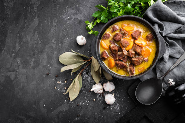 Meat stew, goulash in a cast iron pot Meat stew, goulash in a cast iron pot stew stock pictures, royalty-free photos & images