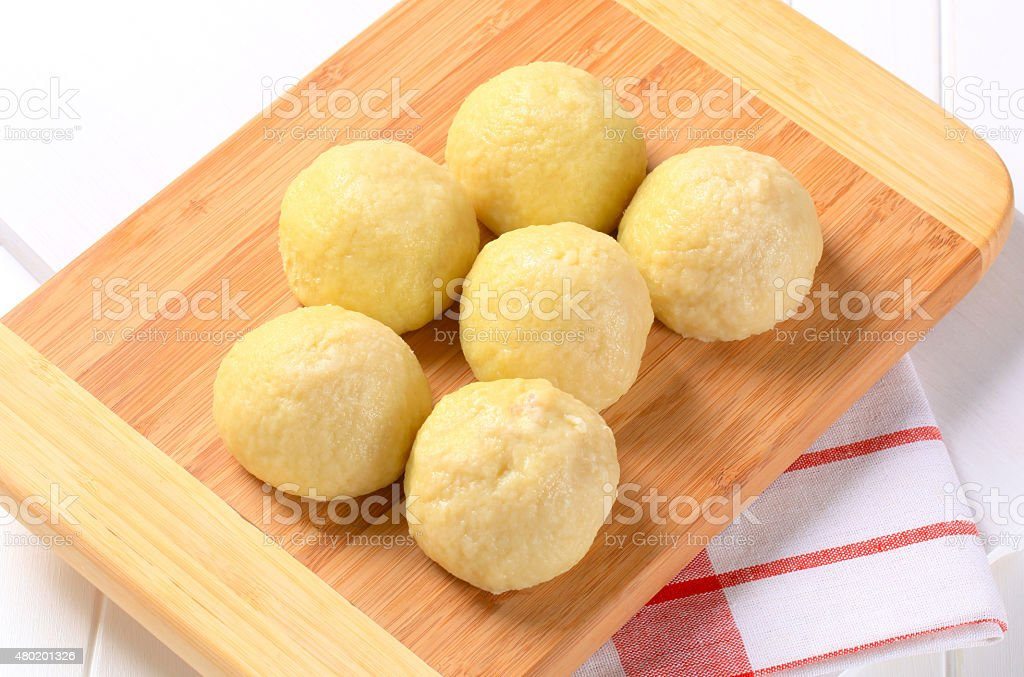 Meat stuffed potato dumplings stock photo
