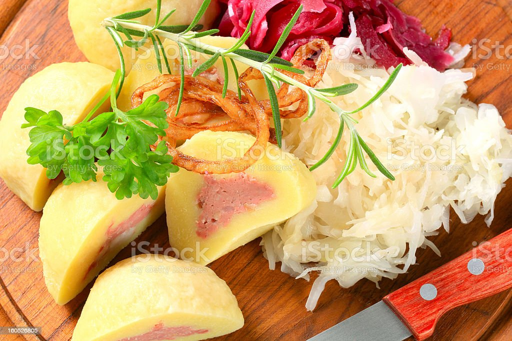 Meat stuffed potato dumplings with shredded cabbage royalty-free stock photo